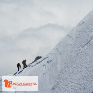 Mountain climbers on a snow covered mountain